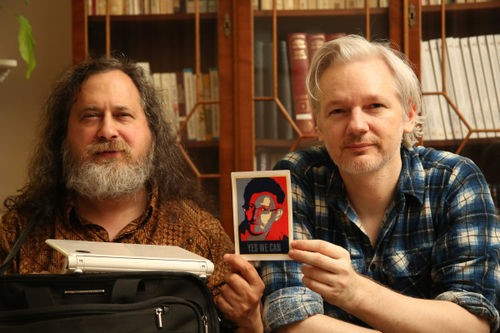"Richard Stallman, Julian Assange and ""Yes We Can"" photo of Edward Snowden. Credit: WIKILeaks."